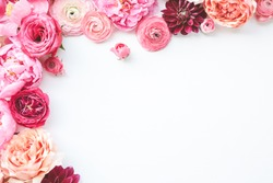 Pink floral / assorted pink flower border on white background