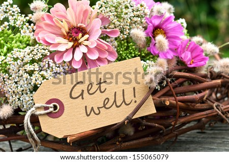 pink flowers and card with lettering get well/get well/english #155065079