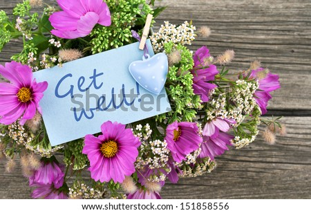 pink flowers and card with lettering get well/get well/flowers #151858556