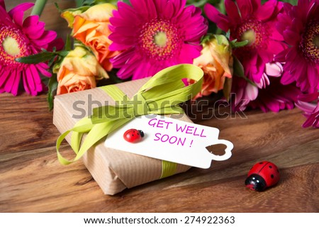 pink flowers and card with lettering get well soon  #274922363