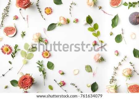pink flowers, petals and figs isolated on white #761634079