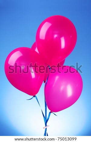 Pink flying balloons  on a blue background