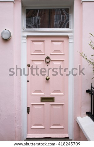 pink front door of a beautiful...