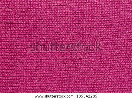 Pink fuchsia knit work. Pink fuchsia wool knit work full frame for warming backdrop or background.