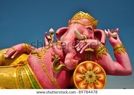 Pink ganecha statue in relaxing protrait on blue sky,Wat Samarn in Chachoengsao Thailand.
