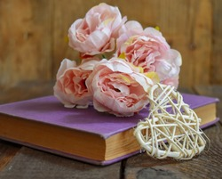 Pink Garden Roses on Book - Wooden Table Background