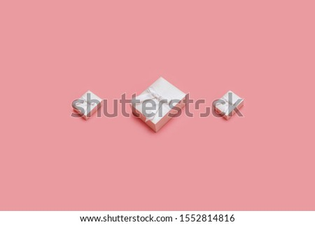pink gift boxes on pastel background. Presents in isometric style. Xmas present or birthday