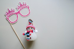 pink girl mask with new year's preparation and snowman toy