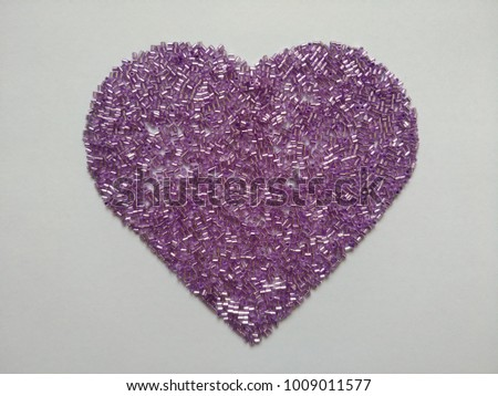 pink glass beads on heart shaped - Shutterstock ID 1009011577