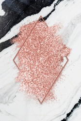 Pink gold glitter with a brownish red rhombus frame on a gray marble background illustration