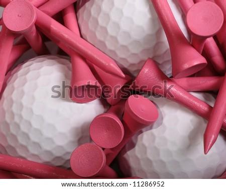 Pink Golf Tees set on white Golf Balls