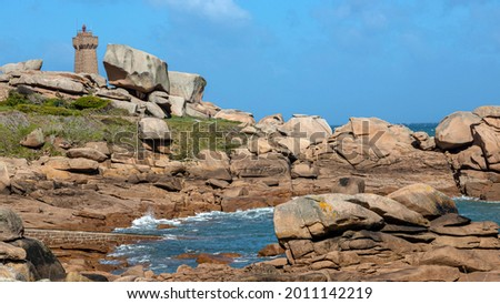 Pink granite coast in Brittany, Côtes d'Armor, Lighthouse of Me Stok fotoğraf ©