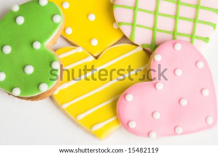 stock-photo-pink-green-and-yellow-polka-dot-heart-shaped-cookies-15482119.jpg