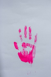 Pink handprint on grey paper
