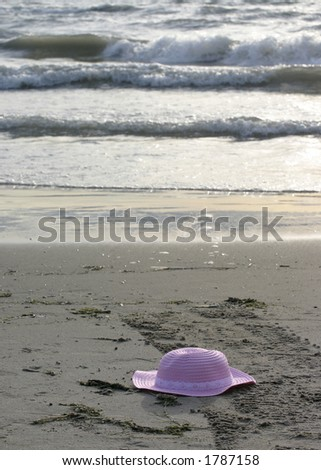 pink hat on the beach