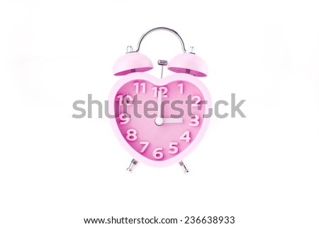 pink heart clock with bell on white background,three o\'clock