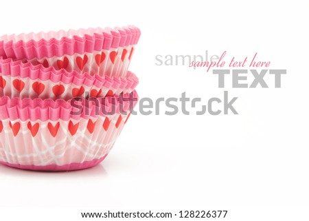 Pink heart cupcake wrappers isolated on white with sample text