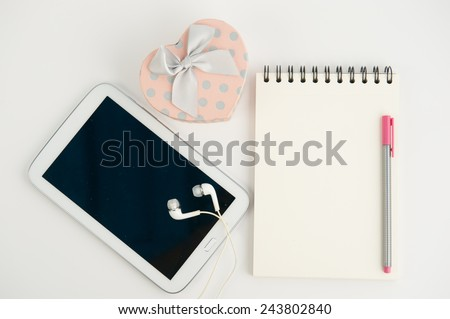 Pink Heart gift box tablet and note book pen on white background