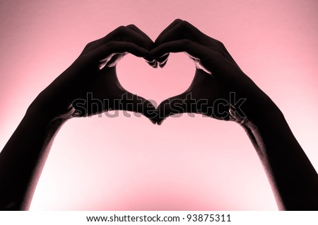 Pink heart hands silhouette