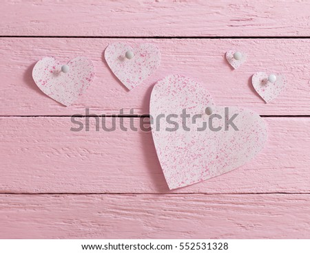 pink heart made of paper on wooden background #552531328