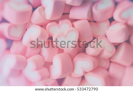 Pink heart marshmallow for sweet love theme and Valentine background concept. Pile of pink heart candy. Pink heart candy pastel theme. Sweet love theme from candy dessert Sweet love holiday background