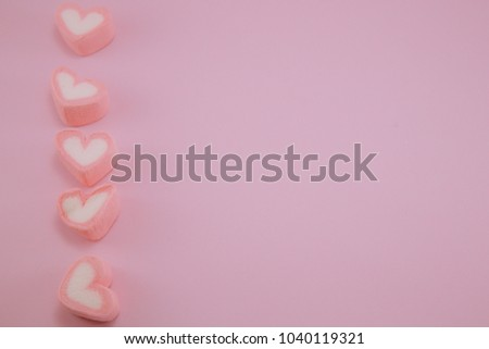 Pink heart marshmallow isolated on pink pastel background with copy space for text #1040119321