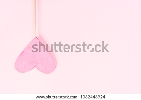 Pink heart on pink background #1062446924