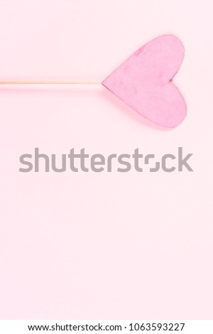 Pink heart on pink background #1063593227