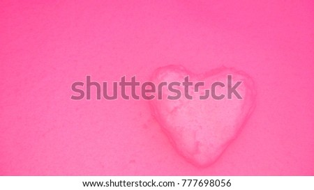 Pink heart on pink background of snow #777698056