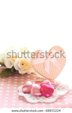 Pink heart shape chocolate and gift box with flower for Valentine\'s Day