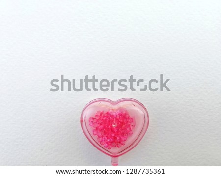 Pink heart shape on white 100 pounds paper background, concept of happy valentine day, friendship, love and care, Love and family bonding #1287735361