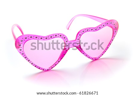 Pink heart shaped sunglasses on white background