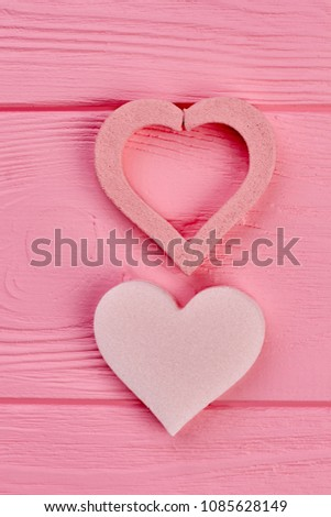 Pink hearts on pink wood, top view. Two decorative heart shapes on colorful wooden board. Valentines holiday concept. #1085628149