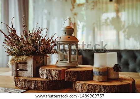 Pink heather in pot,candles, lantern,vintage shutters on background.Getting ready for autumn. Cozy autumn set.pink heather flower. Cozy living space concept. Autumn decor with candles #1489909757