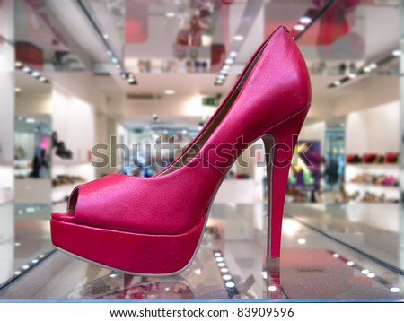 Pink high heel shoe in a store