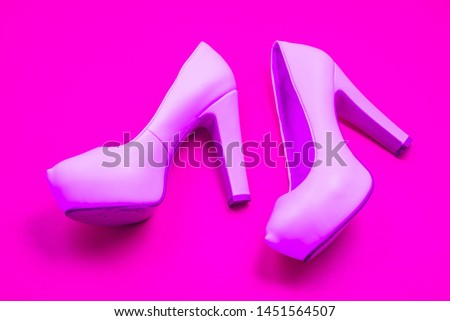 Pink high heeled shoes on pink purple background - top view concept - blank empty room space for text or copy. Suitable for holidays like Valentine's. Classic fashion. Heels walking left. #1451564507