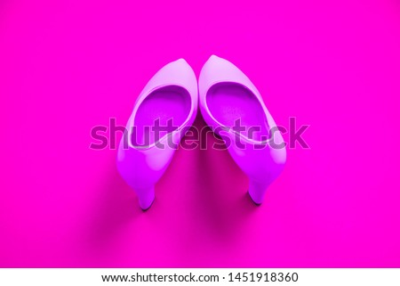 Pink high heeled shoes on pink purple background - top view concept - blank empty room space for text or copy. Suitable for holidays like Valentine's. Classic dress up fashion. Heels pigeon toed #1451918360