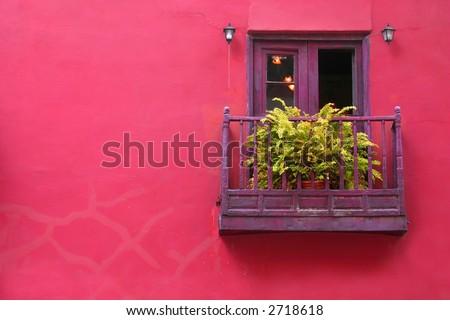 Pink house with purple balcony on Malaga, Spain
