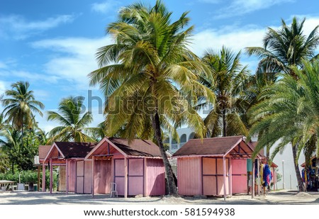Shutterstock Pink huts among palm trees in Antigua island in the Caribbean