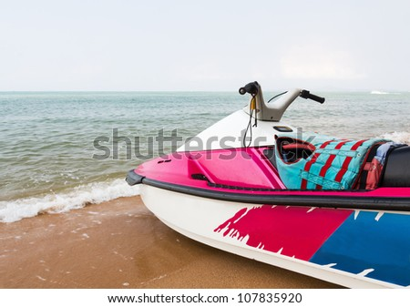 Pink  jet ski close up parked on the beach
