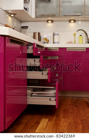 Pink kitchen in city flat