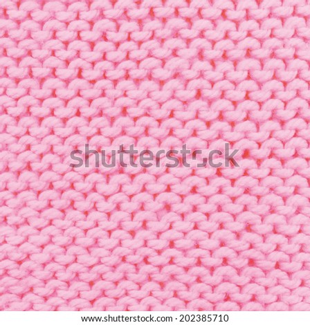 pink knitted background. texture knitted.  handmade work.