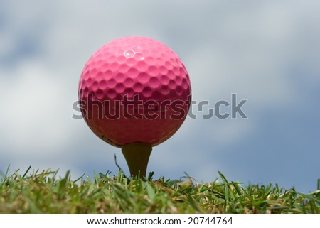 Pink Lady golf ball on a tee
