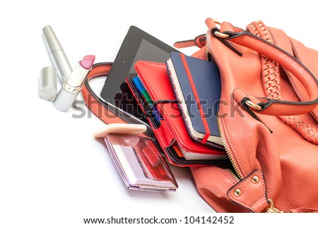 Pink Leather Ladies Handbag with Tablet PC on white background