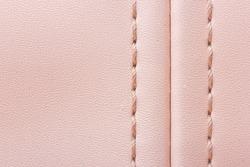 Pink leather woman bag closeup texture.