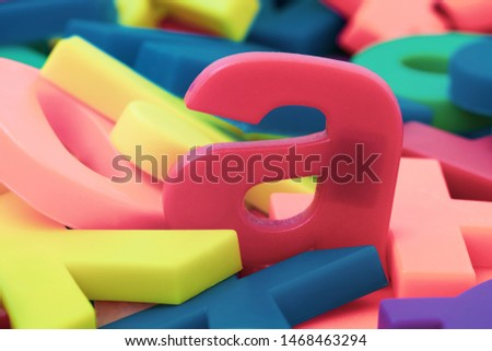 "Pink letter ""a"" on the pile of colorful plastic letters  #1468463294"