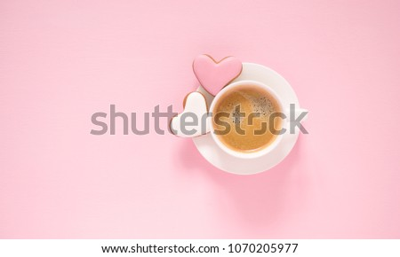 Pink light pastel background. Cup of coffee and ginger biscuits in the shape of a heart. Valentine heart cookies. Flat lay, top view, copy space #1070205977