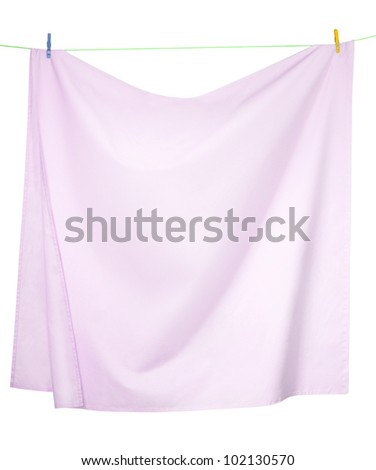 Pink linen sheets drying on a rope, isolated on a white background, with clipping paths
