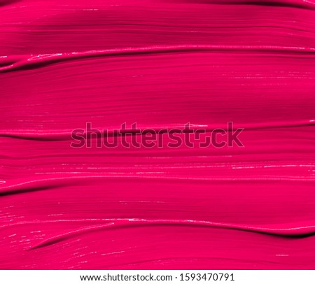 Pink lipstick smudged background. Lipstick or other makeup product swatch. Acrylic paint smeared texture. Gouache brush painted wallpaper. Can be used as an advertisement banner or wallpaper