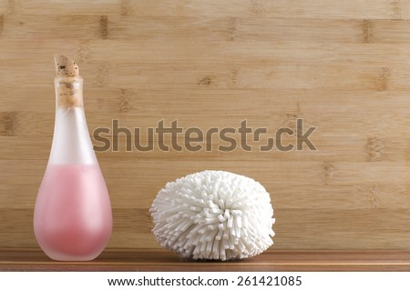 Pink Liquid Body Soap and White Sponge at the Spa